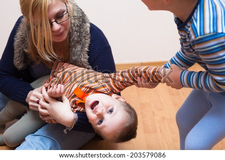 Woman and two kids fighting. - stock photo