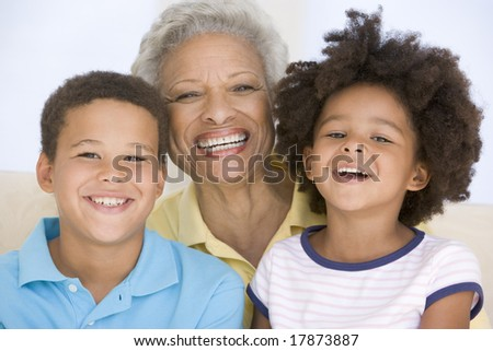 Woman and two young children smiling - stock photo