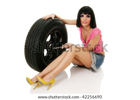 Woman and wheel isolated over white background - stock photo