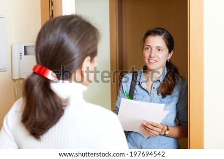 woman answers the questions  at home - stock photo