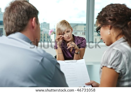 Woman applicant crying during job interview. Over the shoulder view. - stock photo