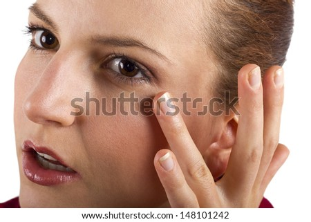 woman applying anti aging cream ointments - stock photo