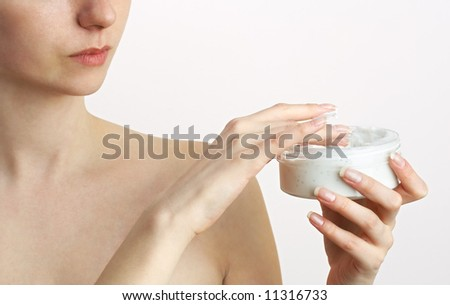 woman applying body cream - stock photo