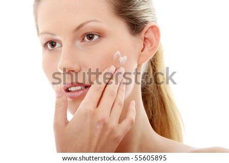 Woman applying cream, isolated on white - stock photo