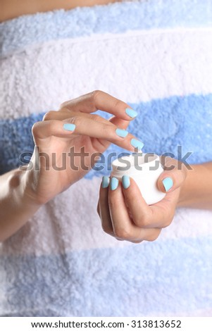 Woman applying cream on hands after shower  - stock photo
