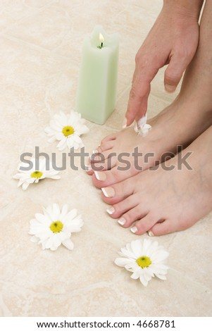 Woman applying cream to her feet
