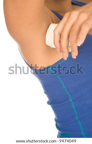 Woman applying deodorant in stick on to her armpits