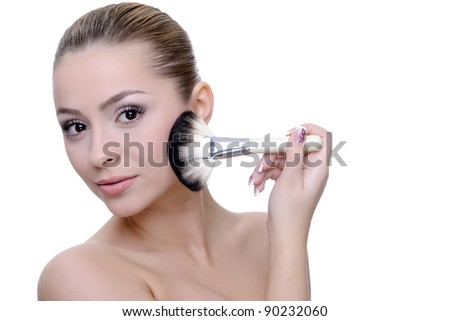 woman applying make-up beauty and health concept