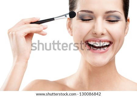 Woman applying make-up with brush, isolated on white. Beauty procedures - stock photo