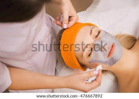 Woman applying mask