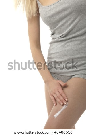 Woman applying moisturizer - stock photo