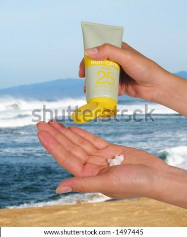 Woman applying sunscreen - stock photo