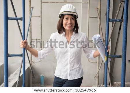 woman architect working at construction site