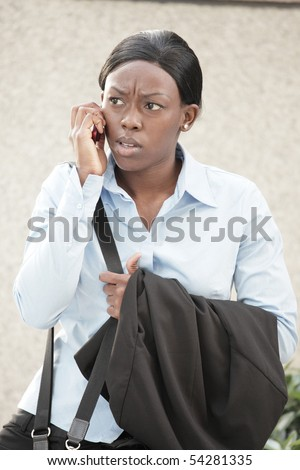 Woman arguing on the phone - stock photo