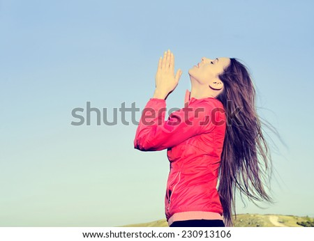 Woman arms raised up to blue sky praying thankful for freedom. Positive human emotions, face expression feeling life perception success, peace of mind concept. Free Happy girl on beach enjoying nature - stock photo