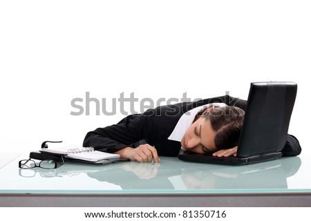 Woman asleep at her desk - stock photo