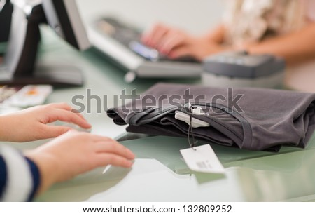 Woman At A Cash Counter, Indoors - stock photo