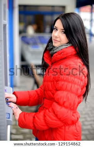 woman at atm - stock photo