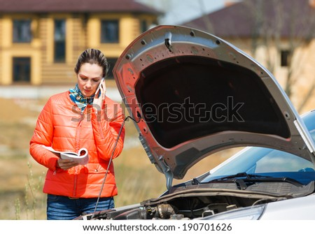 woman at broken car call for help - stock photo