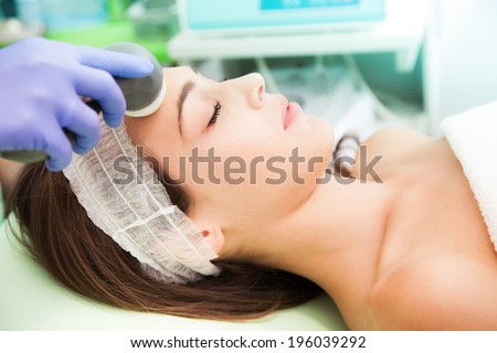 woman at Cosmetic radio-surgery treatment - stock photo