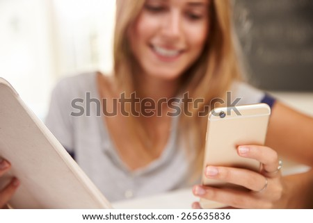 Woman At Home With Digital Tablet And Mobile Phone