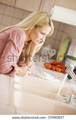 Woman At Kitchen Counter - stock photo