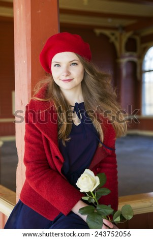 Woman at  local train station with white rose  - stock photo