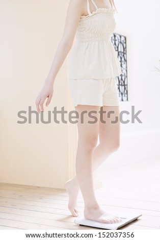 woman at scale - stock photo