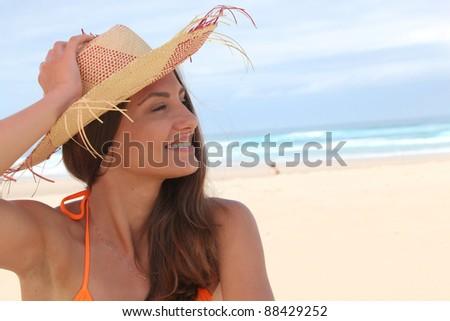 Woman at the beach in bikini - stock photo