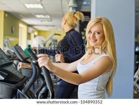 Woman at the gym doing exercise on the treadmill - stock photo