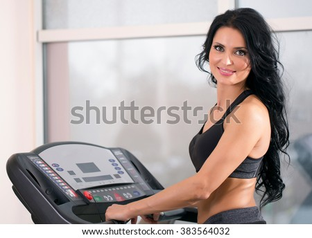 woman at the gym has been running on a treadmill - stock photo