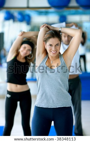 Woman at the gym in a stretching class - stock photo
