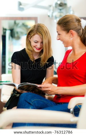 Woman at the hairdresser getting advise on her hair styling or new hair color - stock photo