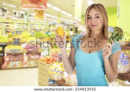 Woman at the supermarket - stock photo
