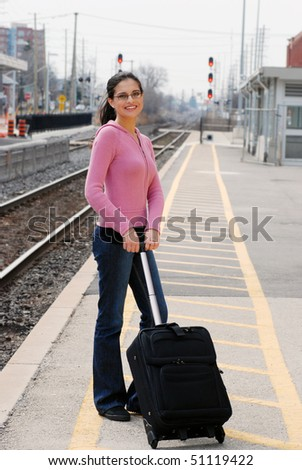 woman at the train station - stock photo