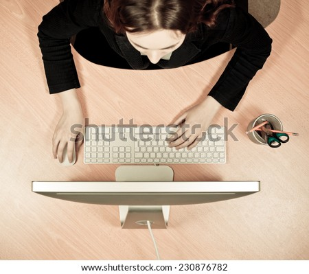 Woman at the work place - stock photo