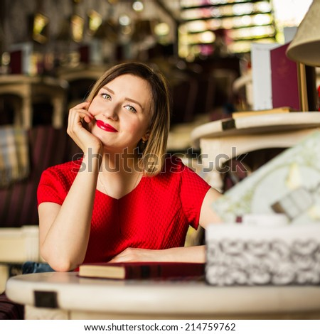 Woman at trendy cafe - stock photo