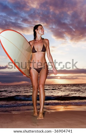 woman at tropic sunset with surfboard in maui, hawaii - stock photo