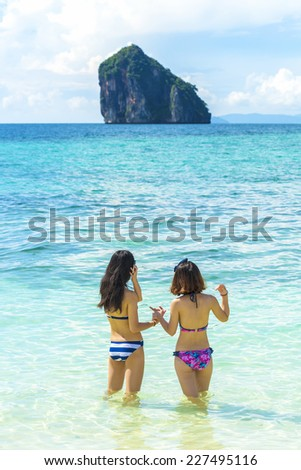 woman at Tropical beach, Andaman Sea, Krabi, Thailand