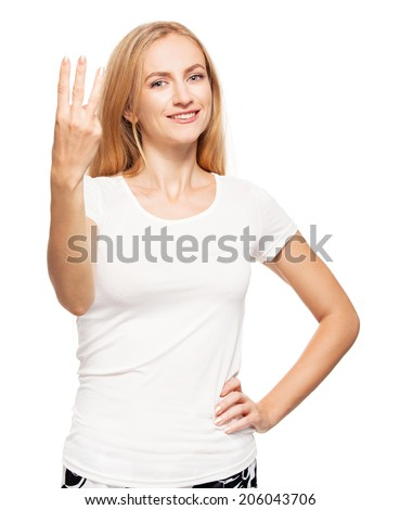 Woman at white background. Young female shows gesture - stock photo