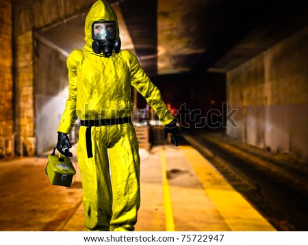 Woman at work in yellow hazardous material protective hazmat suit gas mask rubber gloves and rubber boots checking out a underground train tunnel with geiger counter. Original illustration - stock photo