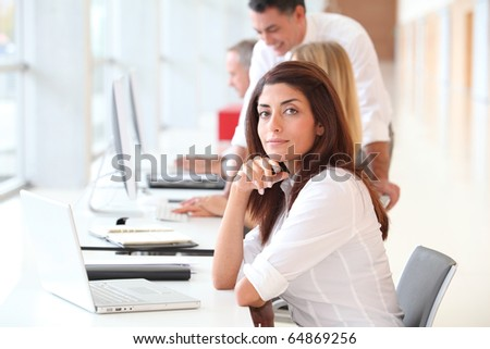 Woman attending business training - stock photo