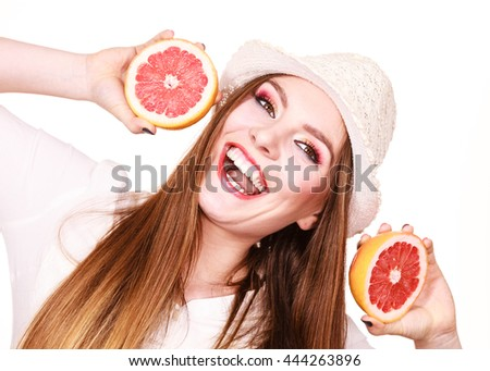 Woman attractive long hair girl colorful eyes makeup holding two halves of grapefruit citrus fruit in hands. Healthy diet food. Summer holidays fun concept, on white