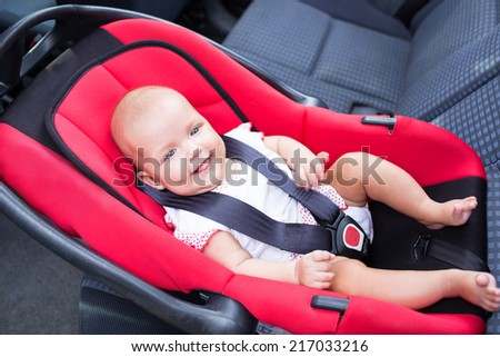 woman baby seats in the car seat - stock photo