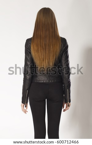 Woman back portrait in black and brown hair