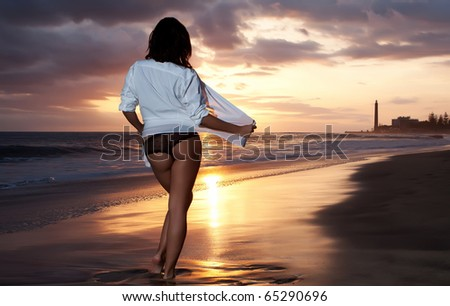 woman back with black lingerie at beach