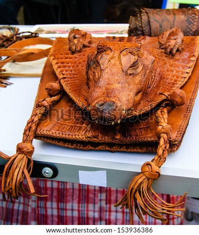 Woman bag with real crocodile head. Flea market in Paris.