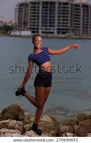 Woman balancing on the rocks - stock photo