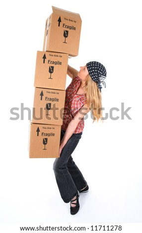 Woman balancing with a stack of cardboard boxes, ready to fall.
