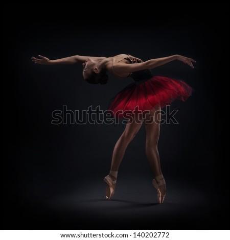 woman ballet dancer on dark background - stock photo